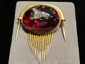 Cabochon Garnet fringe brooch, with diamond bug motif