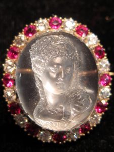 Full face moonstone cameo in Ruby & Diamond frame circa 1890