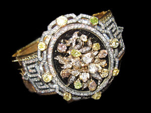 18kt Gold and natural fancy colored Diamond Bangle. Circa 1880